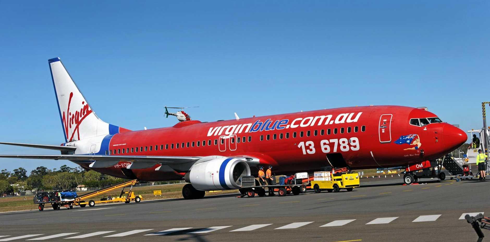 Aeroplanes on the runway at Sunshine Coast Airport, Virgin Australia plane. Photo: Iain Curry / Sunshine Coast Daily