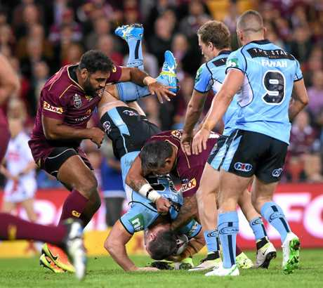 NSW captain Paul Gallen is speartackled by Queensland's Sam Thaiday and Corey Parker.