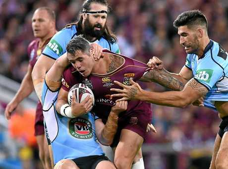 James Tamou of the NSW Blues (right) grabs Corey Parker of the Queensland Maroons.