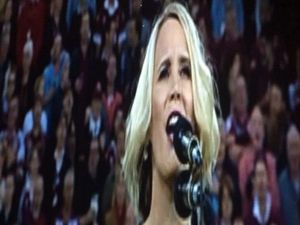 Voice of Siri sings at State of Origin game