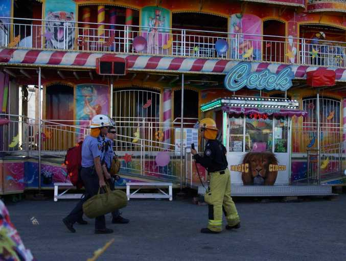 Firefighters on the scene at the Magic Circus ride at Mackay Show this afternoon.
