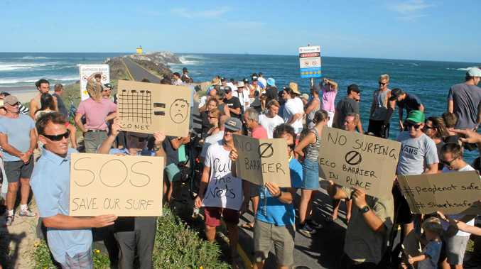 The Department of Industries has confirmed the shark barrier at Lighthouse Beach won't be moved to a new position, despite recent protests from surfers that it will run through the take-off zone.