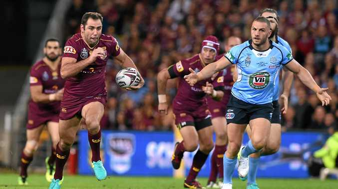 TEAM MAN: Maroons captain Cameron Smith gets into space as Blues player Robbie Farah (right) looks on during the State of Origin II.