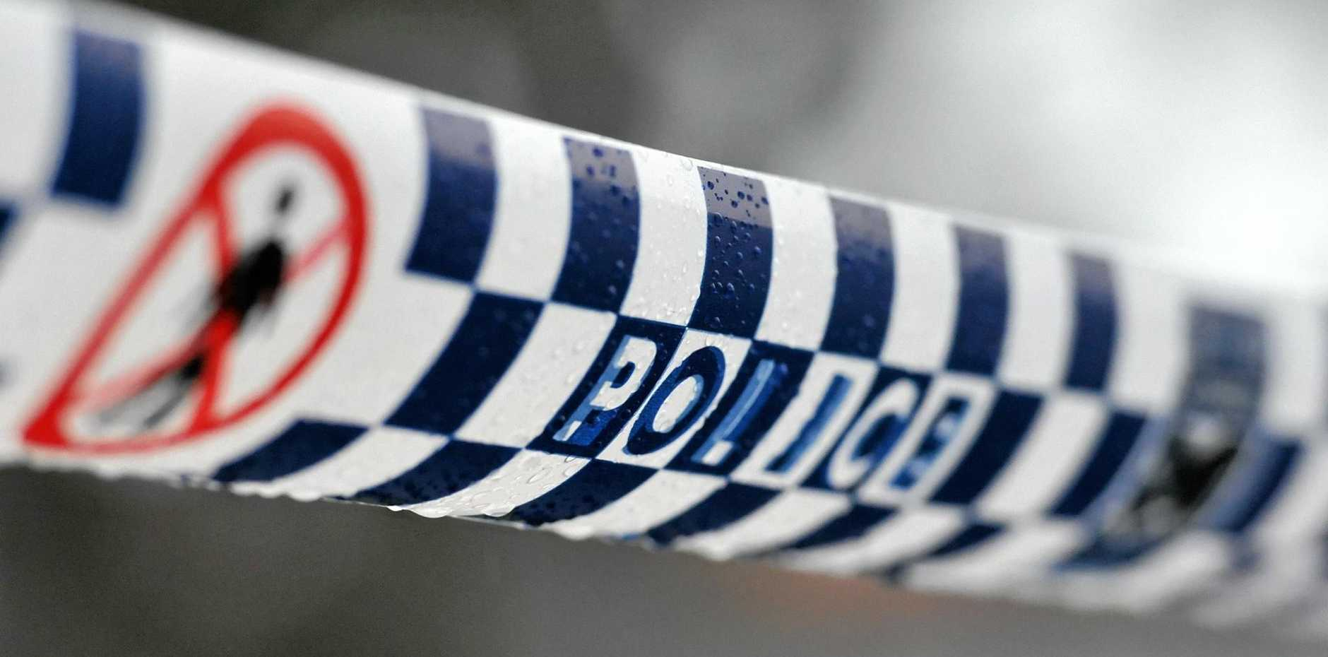 Police tape restricts access to a crime scene north of Sydney, Friday, July 24, 2015. (AAP Image/Joel Carrett) NO ARCHIVING