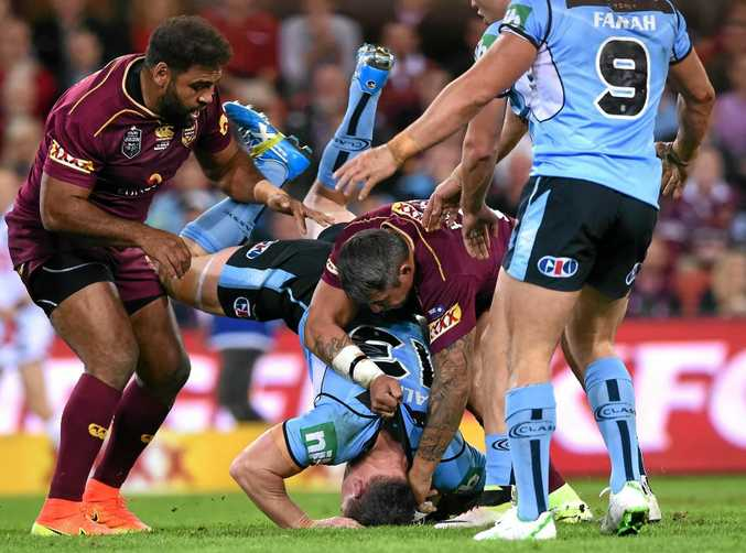 RUBBED OUT: NSW's Paul Gallen is tackled head-first into the turf by Queensland's Sam Thaiday (left) and Corey Parker during State of Origin II.