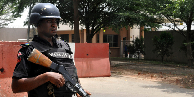 A police officer stand guards in Nigeria.