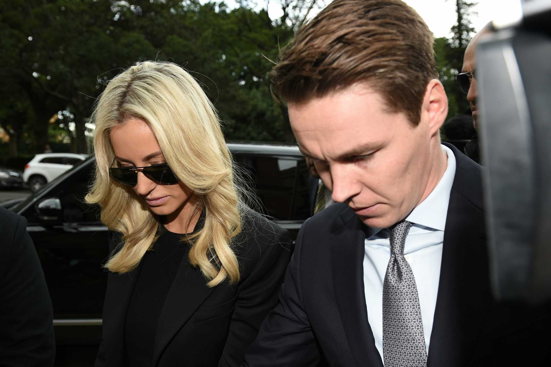 Stockbroker Oliver Curtis and wfe Roxy Jacenko arrive at the NSW Supreme Court in Sydney, Friday. Source AAP