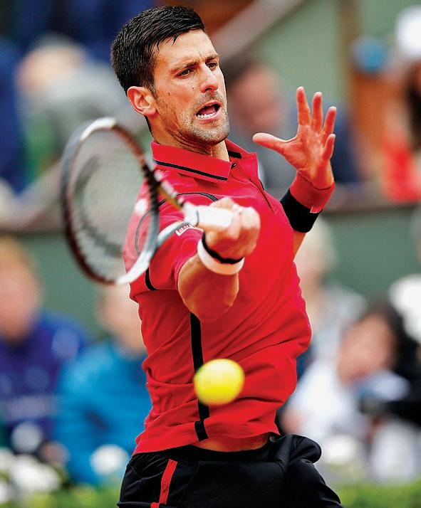 WARM FAVOURITE: Novak Djokovic of Serbia in action against Andy Murray of Britain during their men's singles final match at the French Open tennis tournament at Roland Garros in Paris.