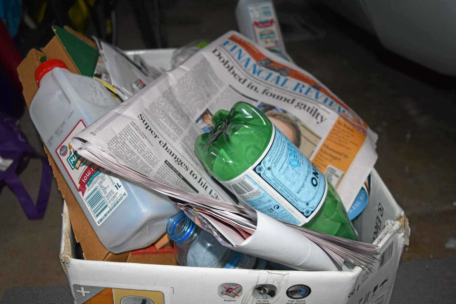 Recycling, the bane of my existence. Even this overflowing box in my garage - which I simply empty into our dumpster - is tired of my moaning about this problem.