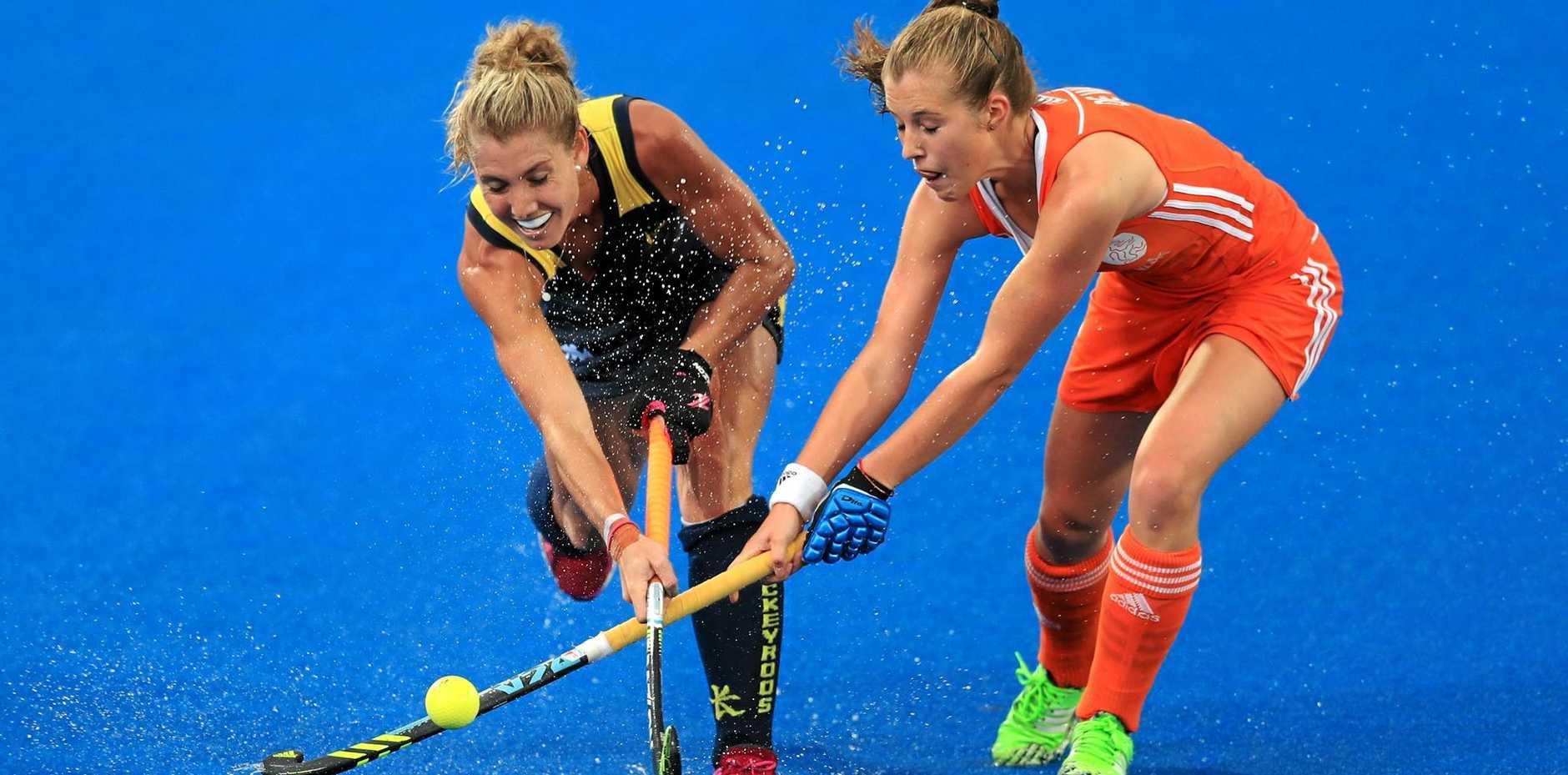UNDER PRESSURE: Australia's Casey Sablowski (left) and Netherland's Margot van Geffen chase the ball during their Champions Trophy clash in London.