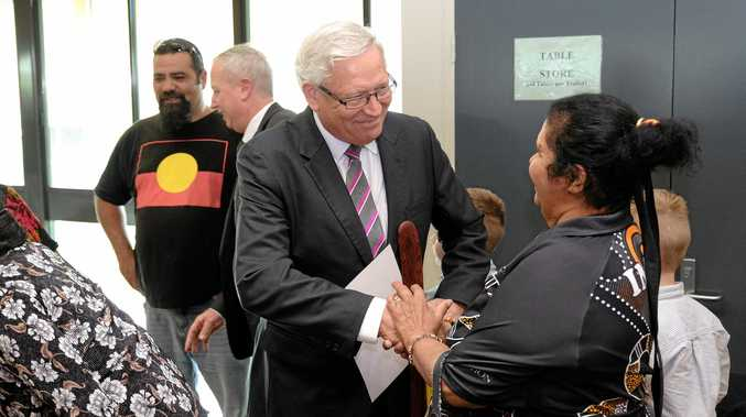 Justice John Reeves shakes hands with Heather Tobane on an historic day in Taroom on Thursday, when the Iman people were granted Native Title over their lands around Taroom and Wandoan.