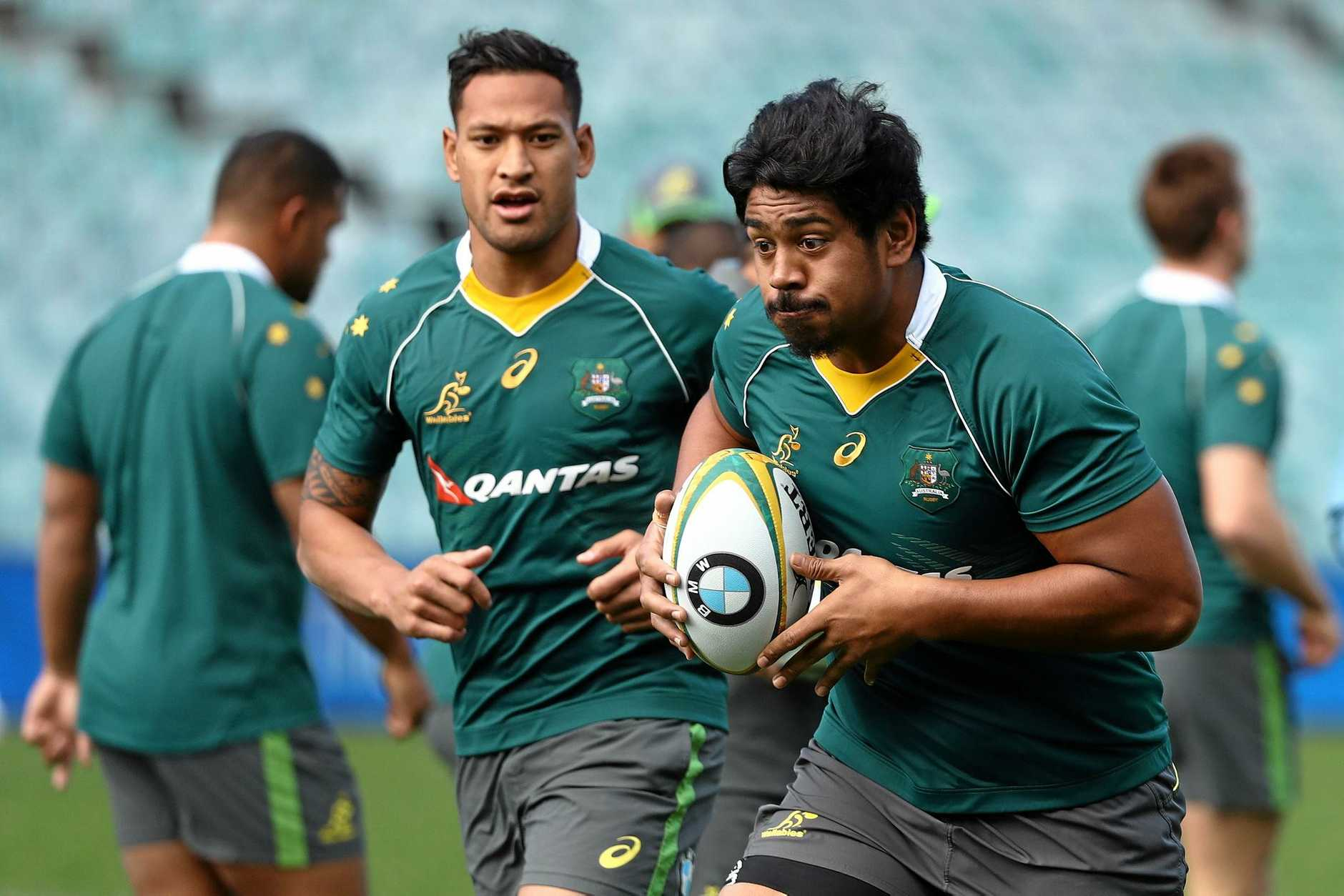 FINE TUNING: Recalled Wallaby Will Skelton (right) and Israel Folau go through their paces in a training session at Allianz Stadium.