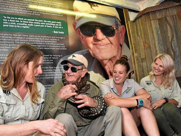 SURPRISE HONOUR: Bob Irwin has been recognised by Wildlife HQ with the opening of a new reptile house dedicated to him. From left is the zoo's head of reptiles Kristi Nageli, and Bob nursing a Bredlii python with 2IC and head of Australasia's Rebecca Roskilley, reptile and primate keeper Suzanne Tonga.