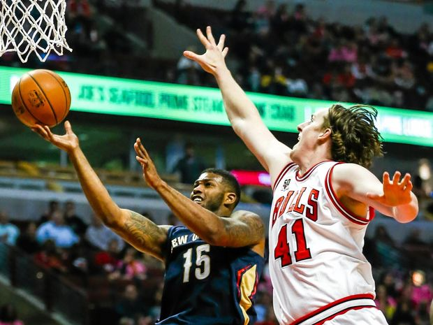Then of the Chicago Bulls, forward Cameron Bairstow tries to prevent a shot by New Orleans Pelicans forward Alonzo Gee  at the United Center in Chicago.