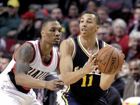 Utah Jazz guard Dante Exum, from Australia (right) works the ball against Portland Trail Blazers guard Damian Lillard.