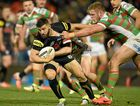 HARD TO STOP: Penrith's Josh Mansour is tackled by Tom Burgess of the Rabbitohs.