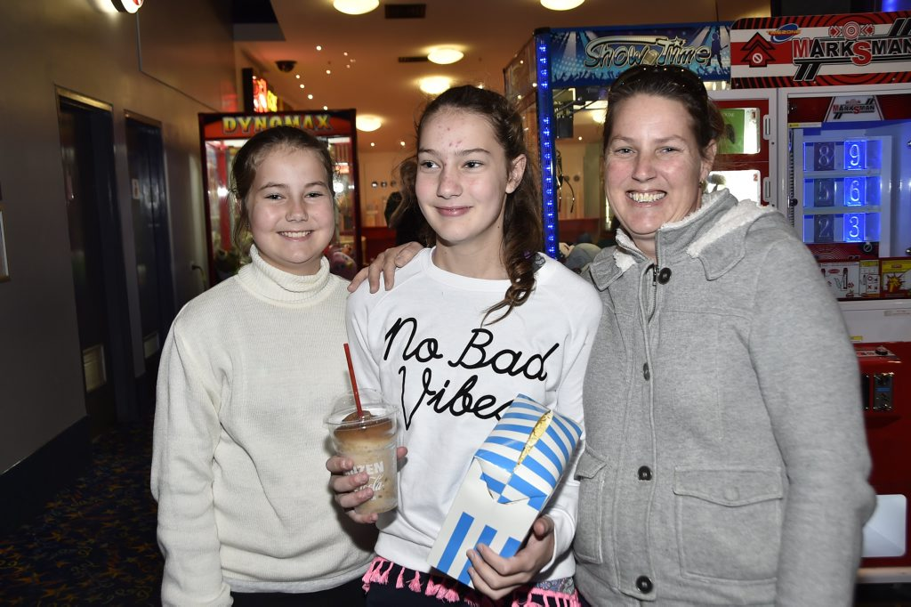 At the movies at Grand Central are Gemma and Brooke Pryce with Lisa Bateman.