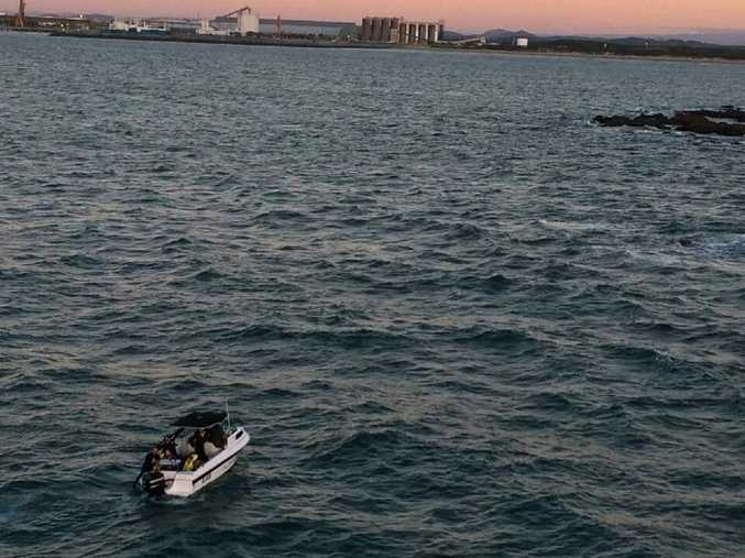 CQ Rescue took this photo of a civilian boat taking the four men back to shore. Contributed