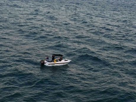 A civilian boat took the four men back to shore as their 21 ft boat had sunk completely.