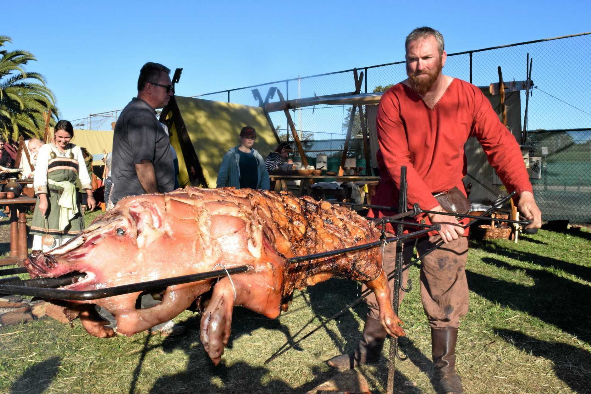I'M STARVING: Warrior and chef Cameron Garrett helped prepare the massive feast for 170 famished Vikings, which included this tasty looking spit roast.