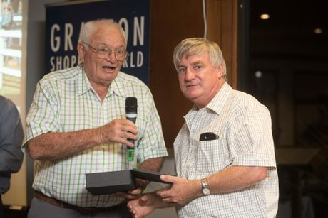 Tim Ryan (right) accepts the Ernie Muller award from Lower Clarence Sports Council member Jim BairdPhoto Adam Hourigan / The Daily Examiner