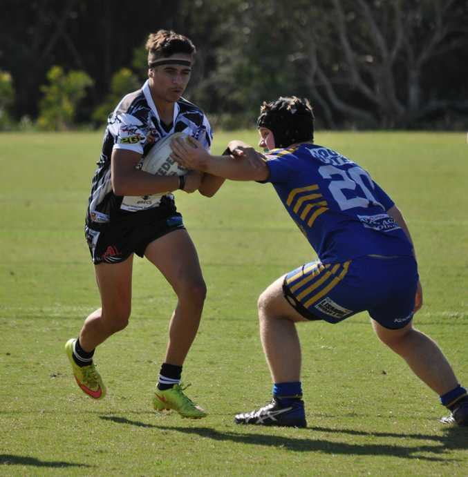 STYLE: Merrick Rainbow-Skinner is cool and calm in attack 10m out from the try line.