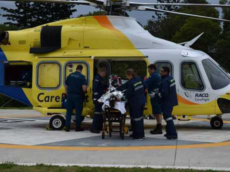 The 12-year-old Monkland girl who suffered serious burns and smoke inhalation in a house fire is transferred to a Careflight helicopter to be flown to Lady Cilento Children's Hospital.