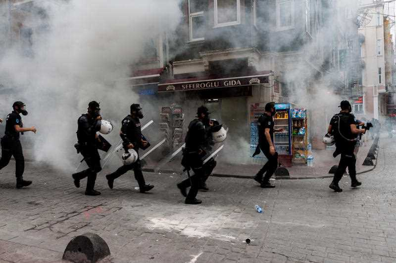 Tear gas fills the streets in Istanbul, Turkey as clashes erupt during banned Pride celebrations on June 26, 2016. The violence comes as massive Pride marches were held worldwide. Police reportedly detained at least 19 people.