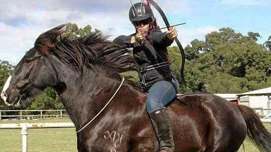 READY, AIM, FIRE: Hayley Larrykin riding bareback bridleless archery.