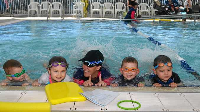 SPLASHING AROUND: Swimming teacher Gemma Zischke made sure Lewis, Paige, William and Lionel were perfecting their kicks for the World's biggest Swimming Lesson on Friday.
