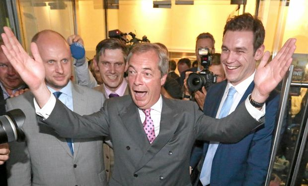 Nigel Farage (C), a  leader of UK Independence Party (UKIP), celebrates after  Leave won in London on June 24, 2016. A referendum  took place on Thursday, 23 June, to decide whether Britain should leave or remain in the European Union. The result of the votes turned out to leave European Union.  ( The Yomiuri Shimbun via AP Images )