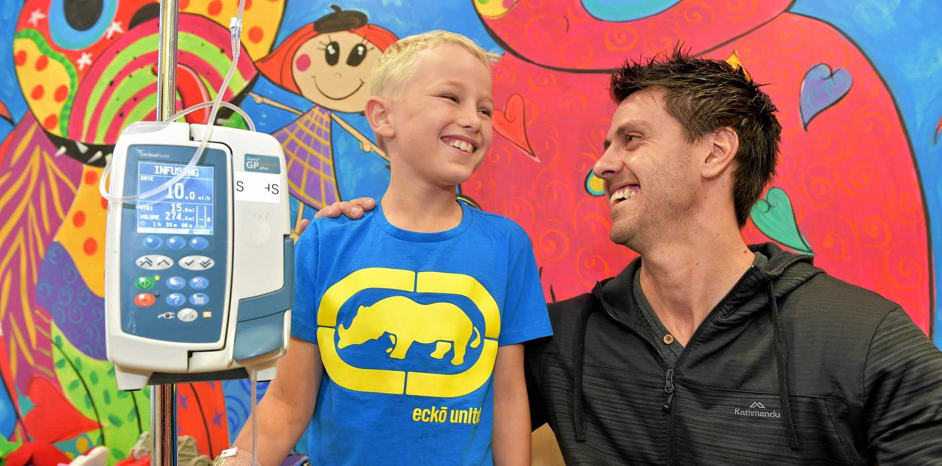 Mt. Kilamanjaro climber Rhys Greedy is raising money for the Children's Ward at Nambour General Hospital. Rhys chats to 10 year old Brodie Tedeschi in the playroom at the Children's Ward at Nambour General Hospital.