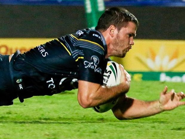 HE'S IN: Lachlan Coote scores a try for the Cowboys against the Sea Eagles last night.