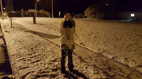 A resident plays in snow in the NSW town of Guyra.