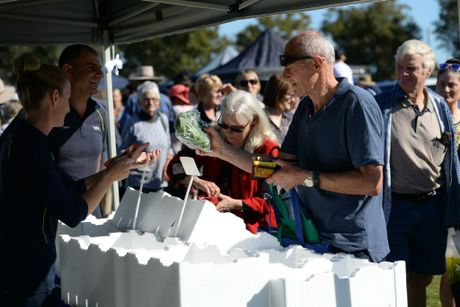 HAPPY SHOPPERS: Meg and Dave Galati from Rosengal serve customers Karen Standish and John Schultz from the Barossa valley at The Flats Farmers Market on Saturday morning at Kendalls Flat. Photo: Mike Knott / NewsMail