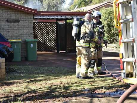 Firefighters extinguish a fire in a unit, Claret St, Wilsonton.