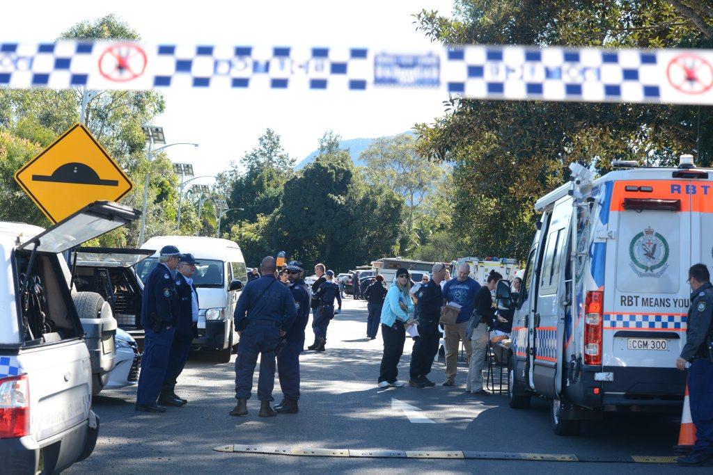 Police undertaking a drug raid on the streets of Nimbin.