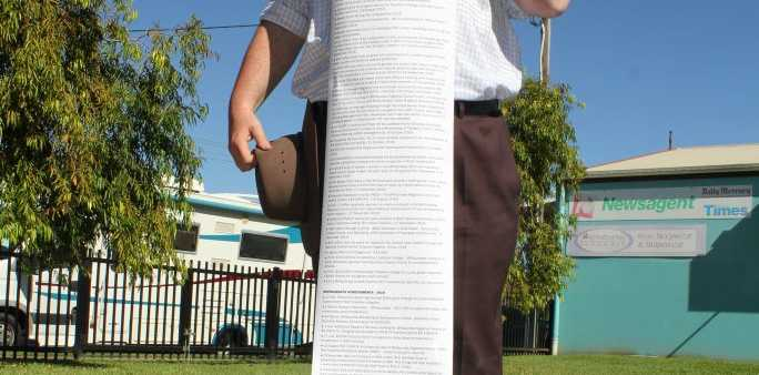 Member for Dawson, George Christensen, holds a list of his achievements in the Whitsundays.Photo Peter Carruthers / Whitsunday Times
