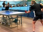 Champion Mitch Connor hits out against Barry Patterson in the final of the Mackay Closed table tennis championships.