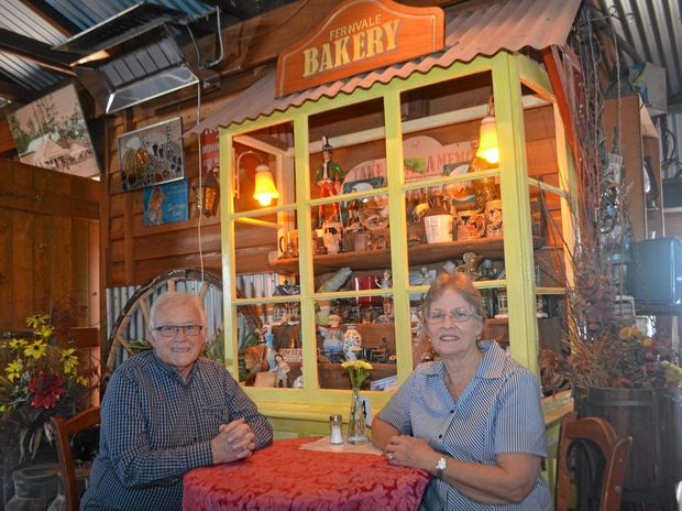 PROUD: Bill sits with wife Lyn in the Old Fernvale Bakery they built from the ground up.