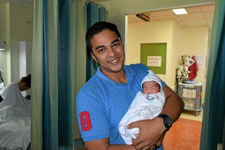 Tahseen Ali with his newborn boy at Gladstone Base Hospital.