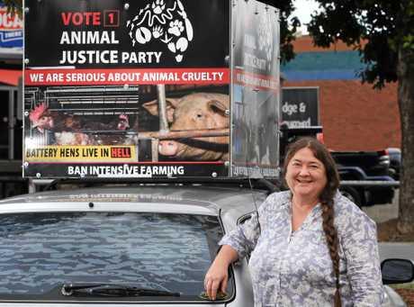 CANDIDATE: Angela Pollard beside her car.