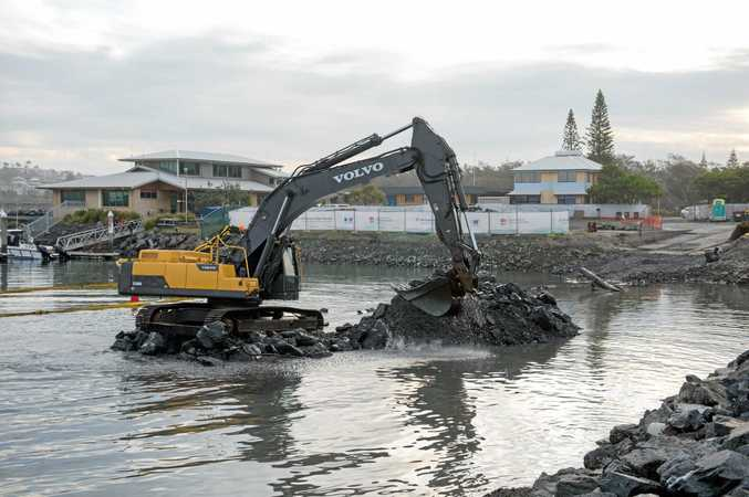 UNDERWAY: Diggers drudging siltation to be placed at the new Slipway site.