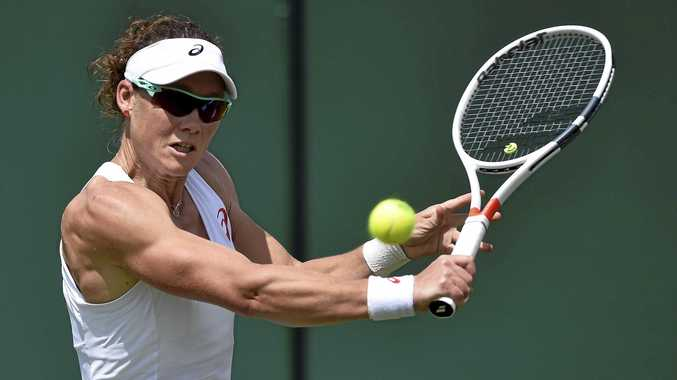 AGGRESSIVE APPROACH: Samantha Stosur of Australia returns to Magda Linette of Poland during their first-round match of the Wimbledon Championships at the All England Lawn Tennis Club in London.