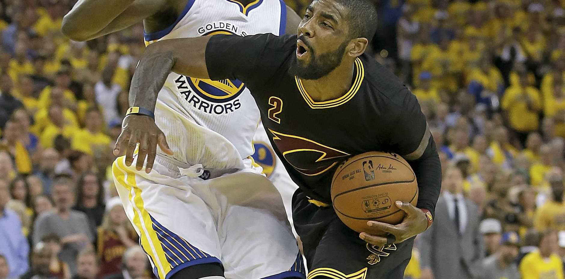 BRAZIL-BOUND: Cleveland Cavaliers guard Kyrie Irving (right) drives against Golden State Warriors forward Draymond Green.