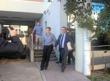 DEADLY MISTAKE: Jameson Routledge, on crutches with a sports injury, leaves court with his lawyer after being sentenced over the crash which killed his friend, Hope Dell, at Caloundra in December 2014.