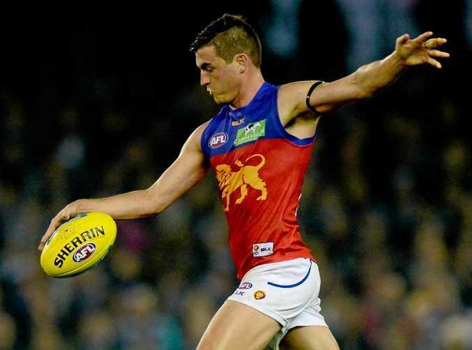 TALKS STALLED: Lions skipper Tom Rockliff kicks the ball during the Round 11 AFL match between the Carlton Blues and Brisbane at Etihad Stadium.