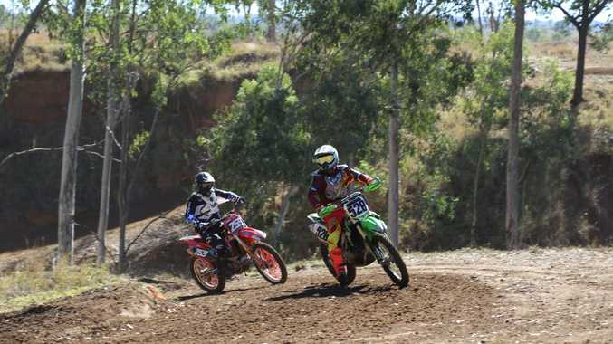 Riders come around a corner at the Motocross Training Day in Mundubbera.