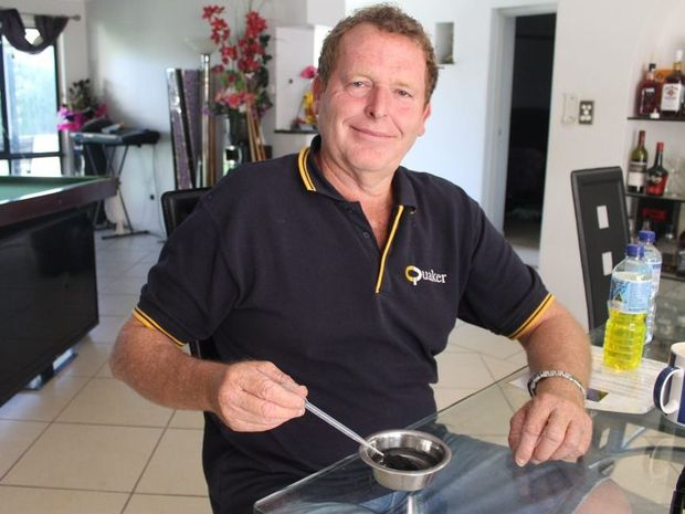 Quaker Chemical Queensland manager Paul Oliver demonstrating a dust suppression chemical used in underground coal mines.