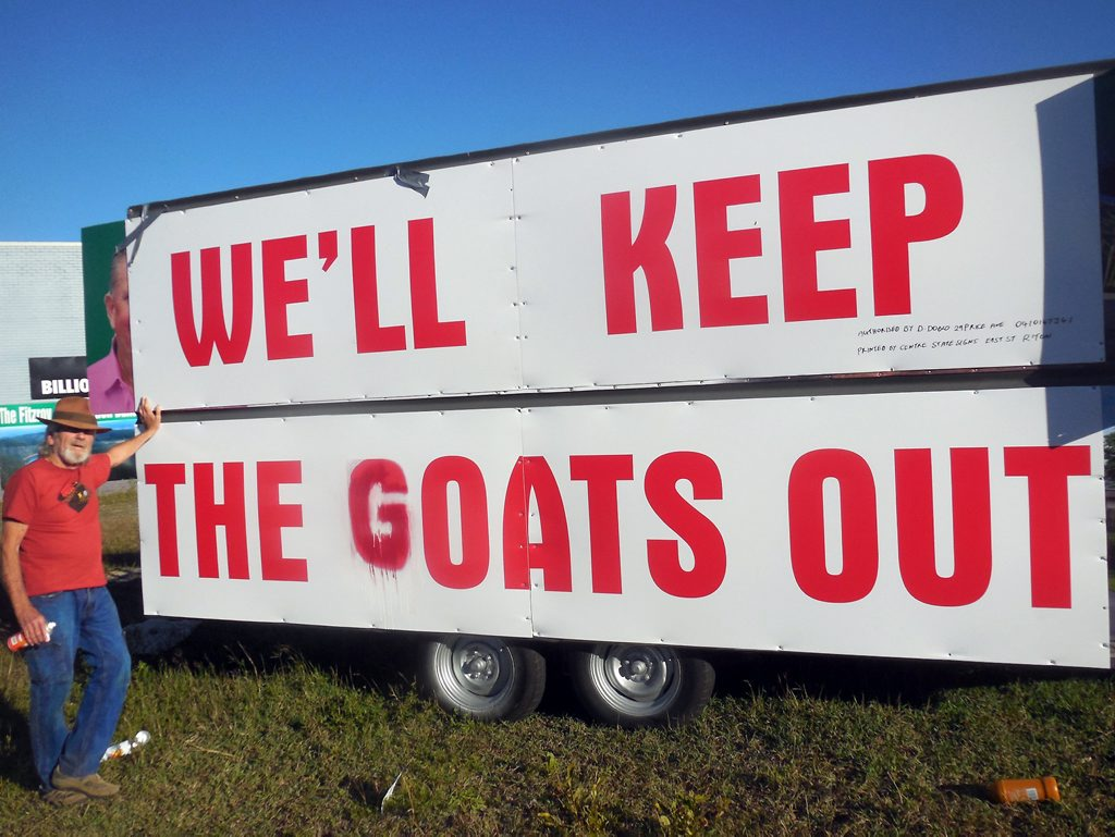 BOLD MOVE: Activist Graeme Dunstan has painted another message over Dominic Doblo's controvercial sign.